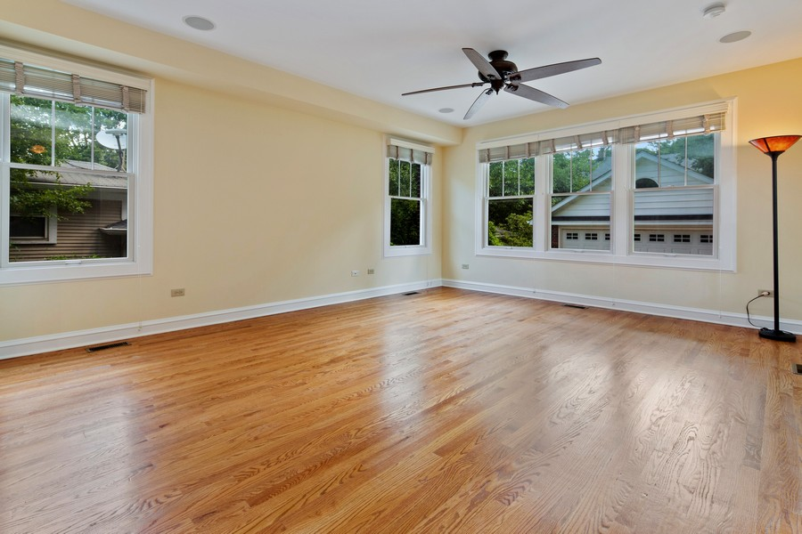 Real Estate Photography - 285 N Main St, Glen Ellyn, IL, 60137 - Family Room. Overlooking lushly landscaped backyar