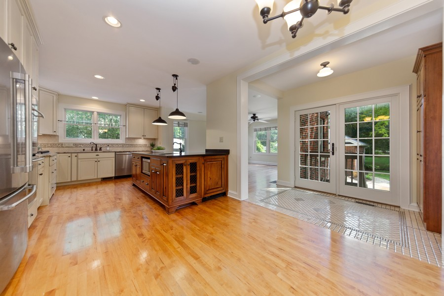 Real Estate Photography - 285 N Main St, Glen Ellyn, IL, 60137 - Kitchen.  Easy assess to the private back deck and