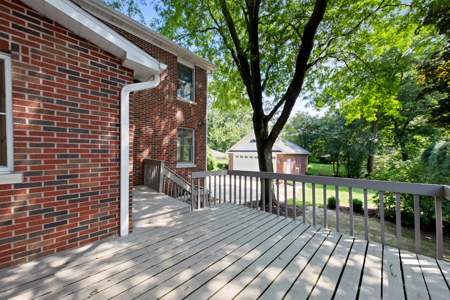 Real Estate Photography - 285 N Main St, Glen Ellyn, IL, 60137 - Exterior Back.  Wrap around deck overlooking backy