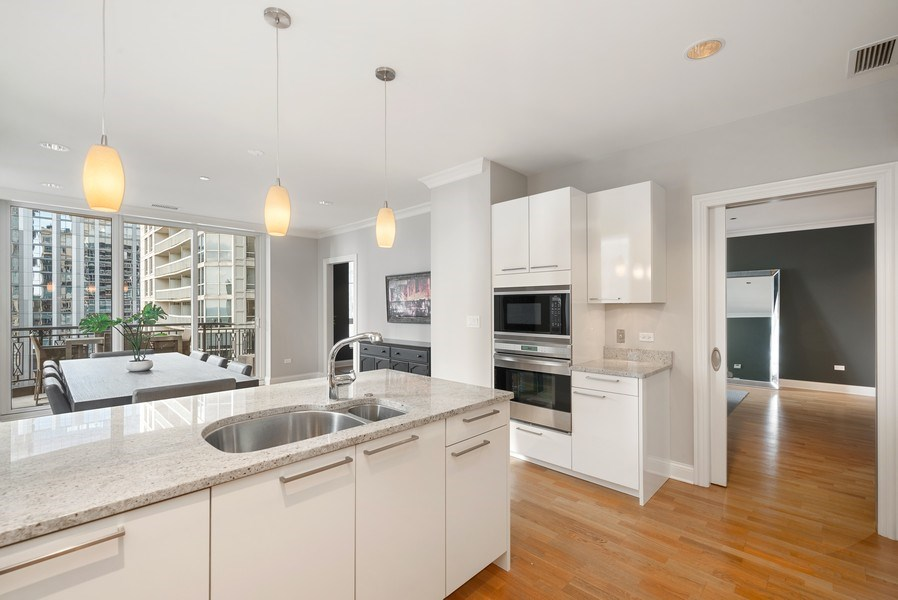 Real Estate Photography - 10 E Delaware Pl, 27B, Chicago, IL, 60611 - Kitchen/Dining