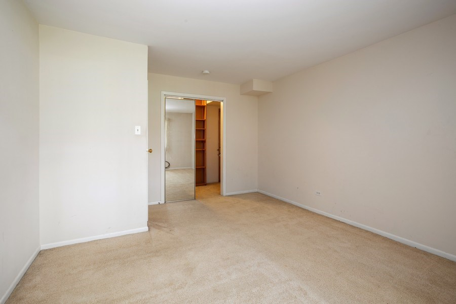 Real Estate Photography - 924 W Irving Park Rd, #106, Bensenville, IL, 60106 - Bedroom