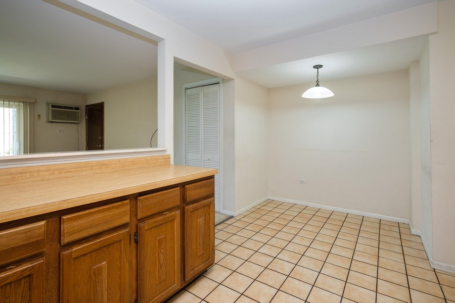 Real Estate Photography - 924 W Irving Park Rd, #106, Bensenville, IL, 60106 - Kitchen / Dining Room