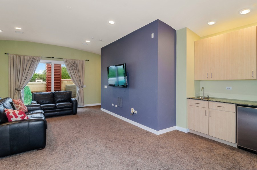 Real Estate Photography - 2141 W. Churchill Street, Chicago, IL, 60647 - Family Room with Wet Bar & Roof Deck