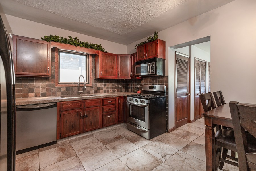 Real Estate Photography - 7940 W Fletcher St, Elmwood Park, IL, 60707 - Kitchen