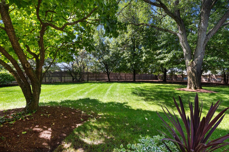 Real Estate Photography - 2042 Trent Ct, Glenview, IL, 60026 - Rear View of Spacious Backyard