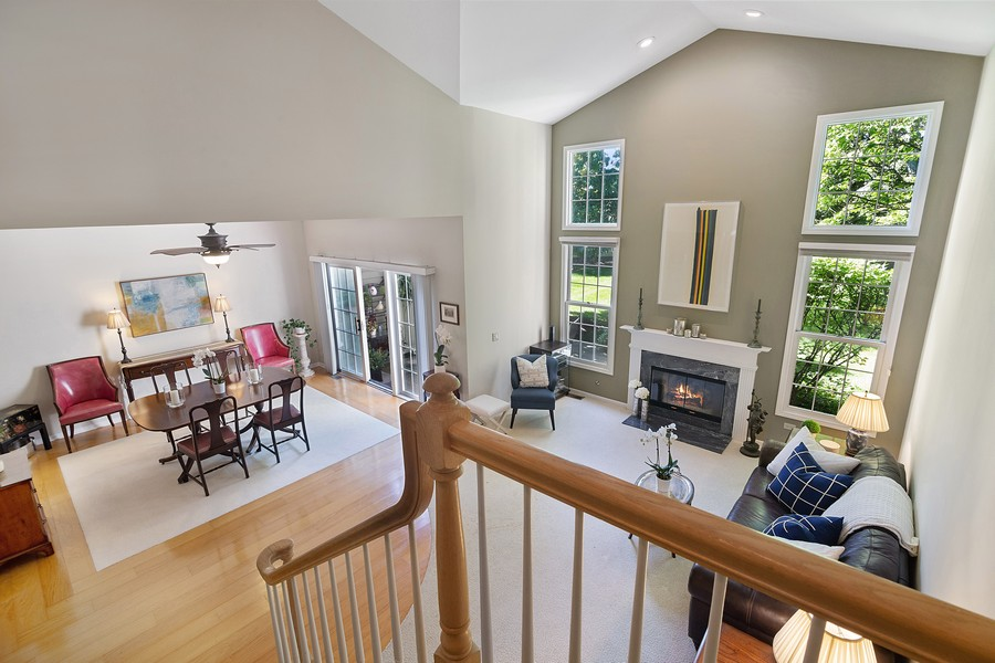 Real Estate Photography - 2042 Trent Ct, Glenview, IL, 60026 - View from above: Dining Room/Living Room w/ firepl