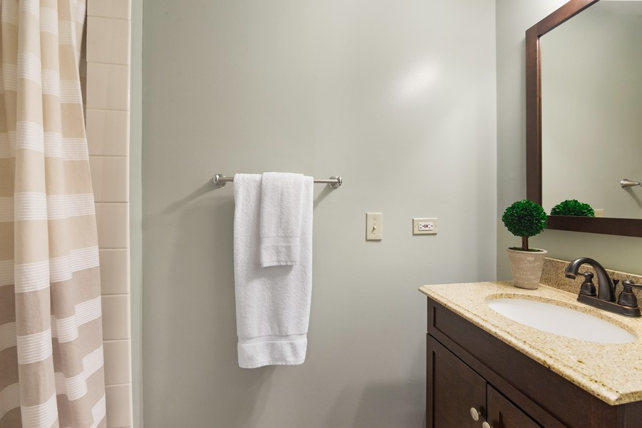 Real Estate Photography - 2042 Trent Ct, Glenview, IL, 60026 - Basement Half Bath Shower & Vanity