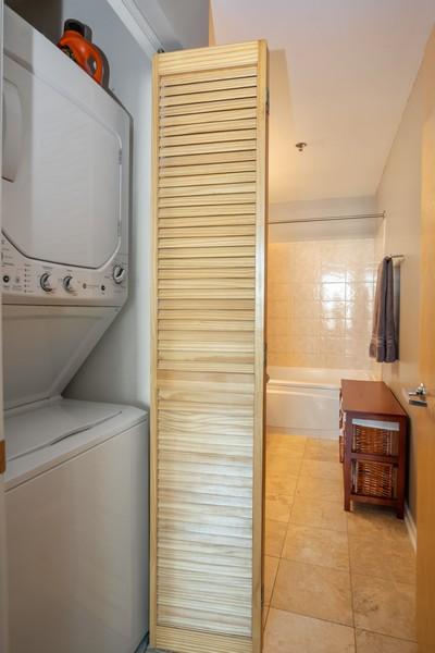 Real Estate Photography - 700 W Van buren, 1403, Chicago, IL, 60607 - Laundry Room