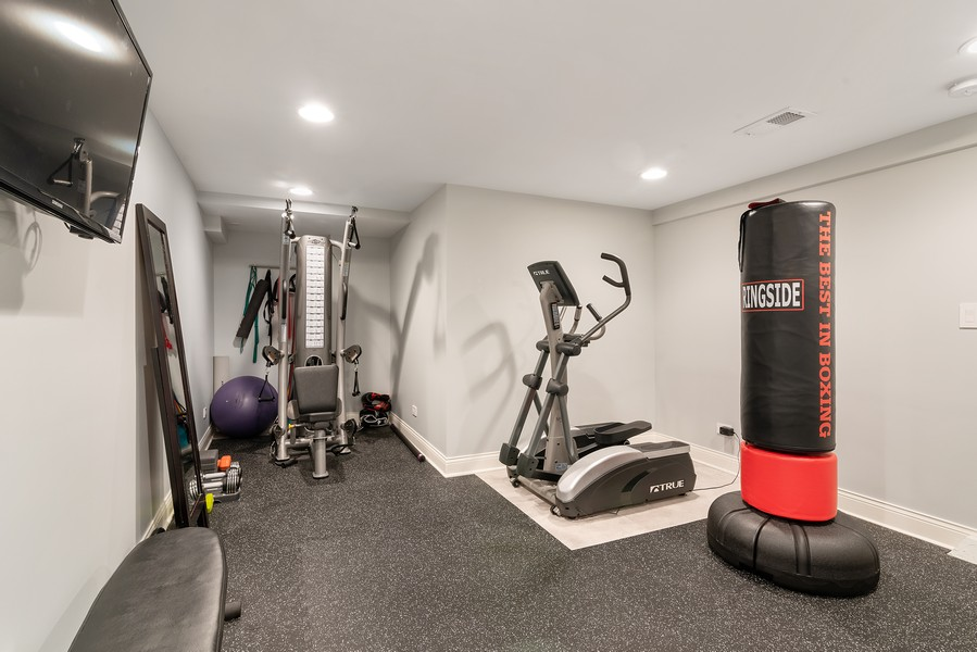 Real Estate Photography - 832 Leyden Ln, Wilmette, IL, 60091 - Lower Level Exercise Room