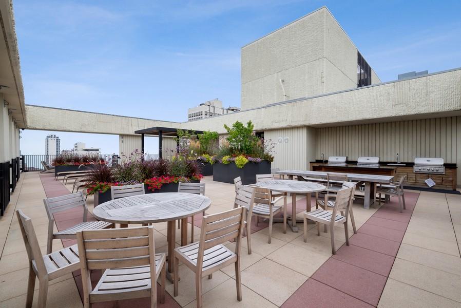 Real Estate Photography - 100 E Bellevue, Apt 25E, Chicago, IL, 60611 - Patio/Outdoor Grilling Area