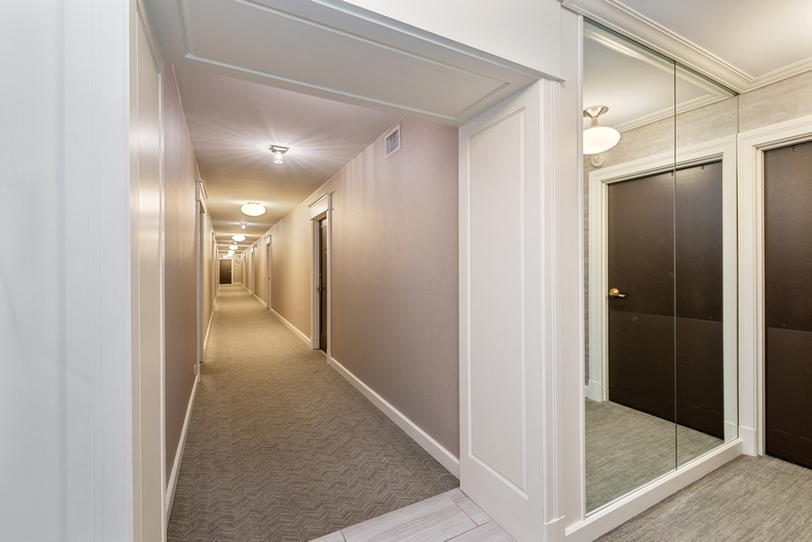 Real Estate Photography - 777 N Michigan Ave, 2506, Chicago, IL, 60611 - 25th floor hallway fresh decor!