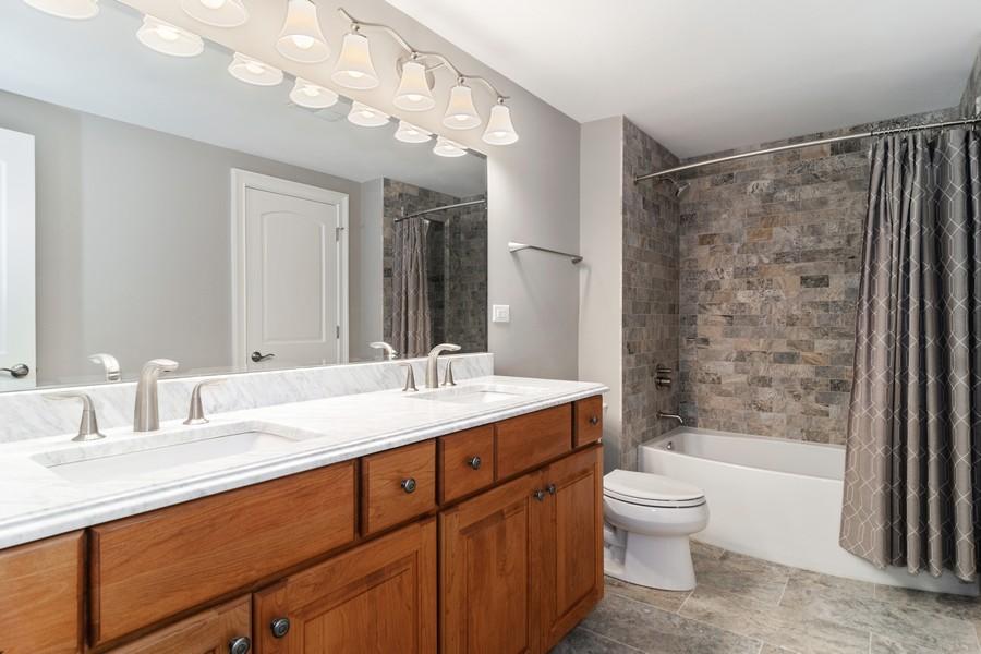 Real Estate Photography - 1335 Calcutta Ln, Naperville, IL, 60563 - Basement Bathroom