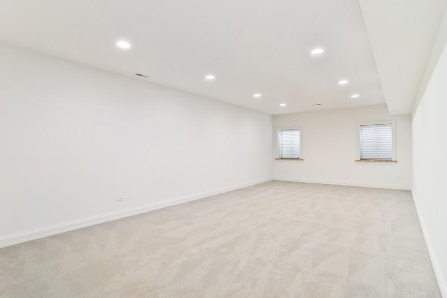 Real Estate Photography - 1335 Calcutta Ln, Naperville, IL, 60563 - Media Room (Basement)