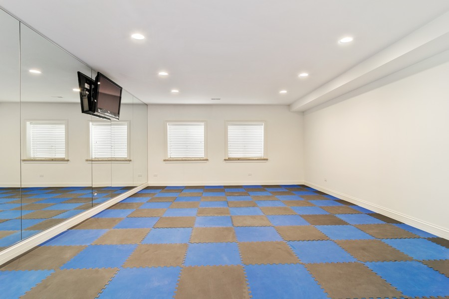 Real Estate Photography - 1335 Calcutta Ln, Naperville, IL, 60563 - Exercise Room (Basement)