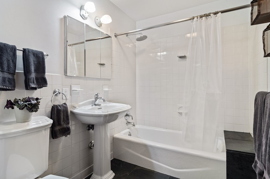 Real Estate Photography - 5029 N Sawyer Ave, Chicago, IL, 60625 - !st floor Bathroom