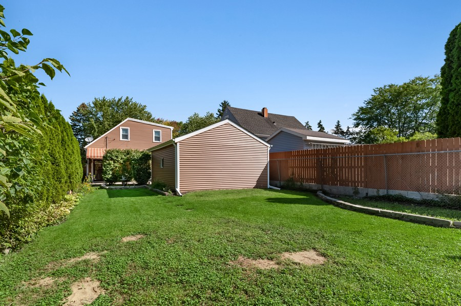 Real Estate Photography - 613 Redwing, Round Lake, IL, 60073 - Rear View