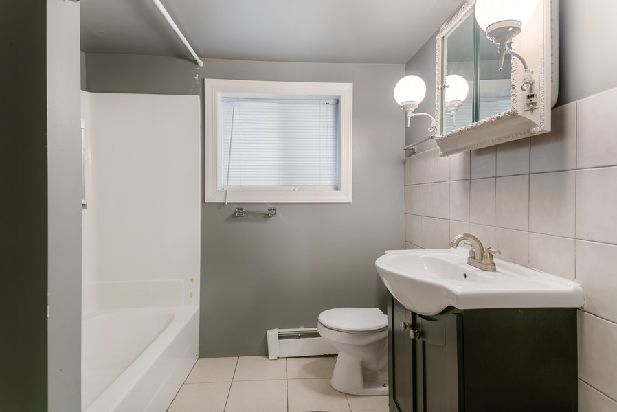 Real Estate Photography - 7515 N Claremont Ave, Chicago, IL, 60645 - Garden Unit Bathroom
