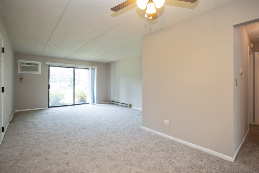 Real Estate Photography - 639 Briar Hill, Unit 1, Addison, IL, 60101 - Living Room/Dining Room