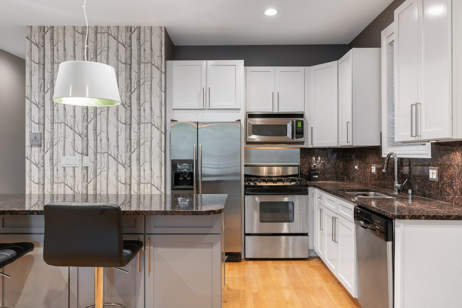 Real Estate Photography - 906 N Hermitage, Unit 1, Chicago, IL, 60642 - Kitchen