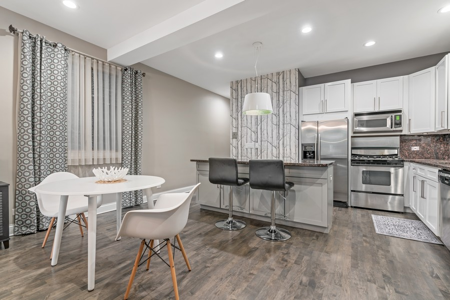 Real Estate Photography - 906 N Hermitage, Unit 1, Chicago, IL, 60642 - Dining Area 2