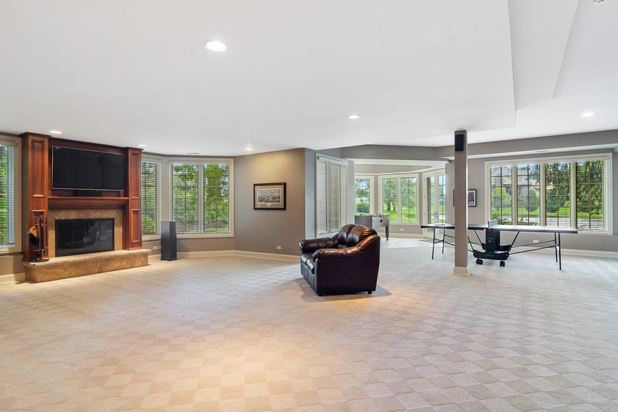 Real Estate Photography - 4 Kensington Drive, North Barrington, IL, 60010 - Lower Level Recreation Area with Walk Out