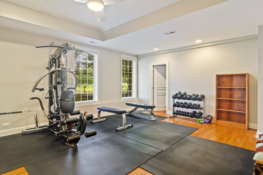 Real Estate Photography - 4 Kensington Drive, North Barrington, IL, 60010 - Lower Level Exercise Room with Full Bath