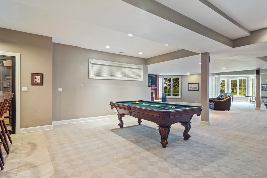 Real Estate Photography - 4 Kensington Drive, North Barrington, IL, 60010 - Lower Level Recreation Area