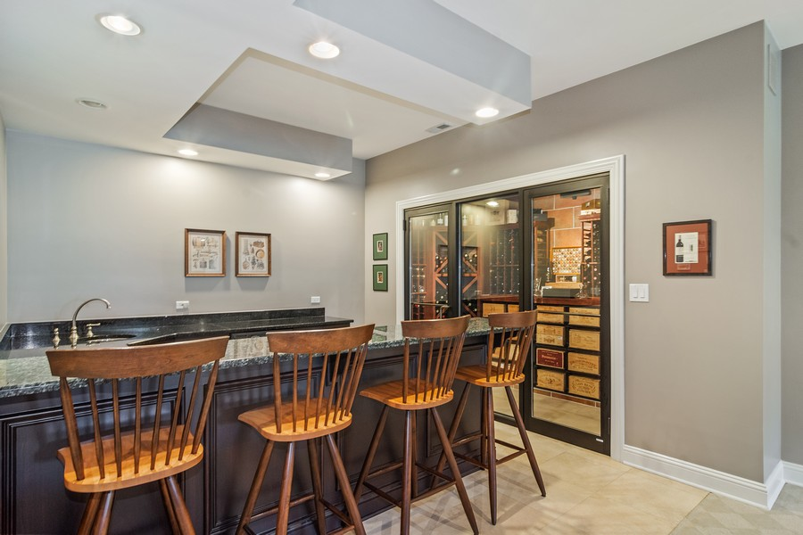 Real Estate Photography - 4 Kensington Drive, North Barrington, IL, 60010 - Bar with Walk In 750 Bottle Wine Room