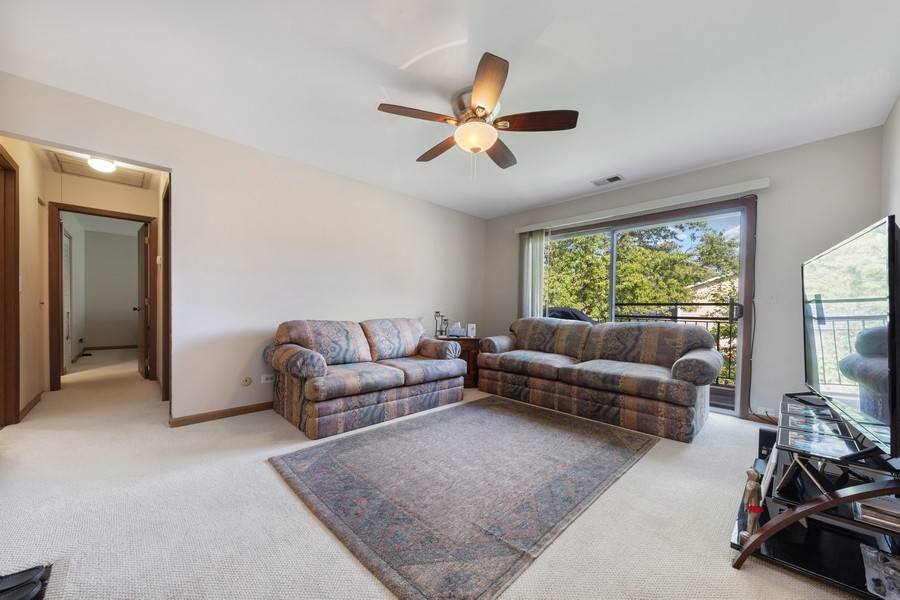 Real Estate Photography - 7010 Newport Dr, Unit 204, Woodridge, IL, 60517 - Family Room