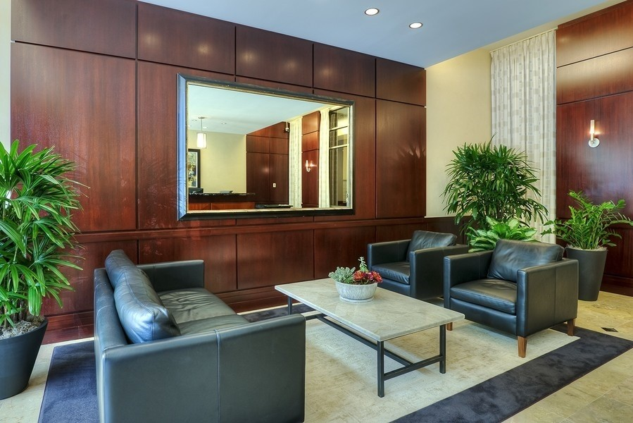 Real Estate Photography - 807 Davis Street, 504, Evanston, IL, 60201 - Sherman Plaza--Lobby and Front Desk