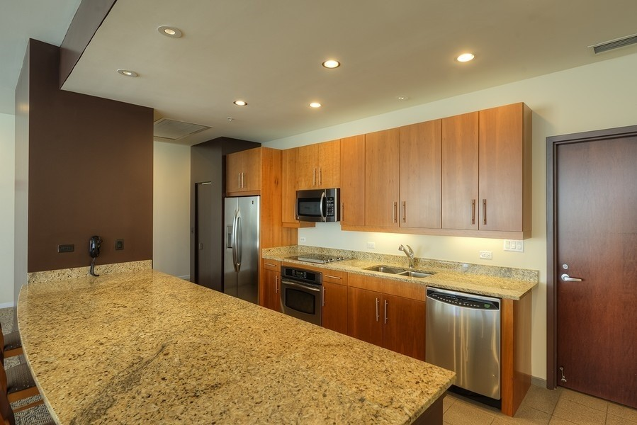 Real Estate Photography - 807 Davis Street, 504, Evanston, IL, 60201 - Sherman Plaza--Hospitality Room Kitchen