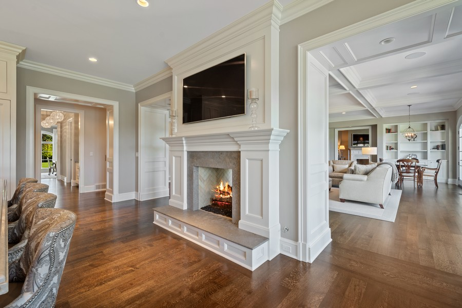 Real Estate Photography - 84 Dundee Ln, Barrington Hills, IL, 60010 - Kitchen with Fireplace & Views of Great Room