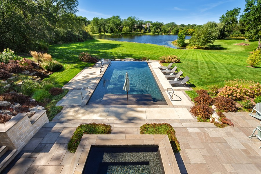 Real Estate Photography - 84 Dundee Ln, Barrington Hills, IL, 60010 - Views of Spa, Pool, Rear Yard & Lake