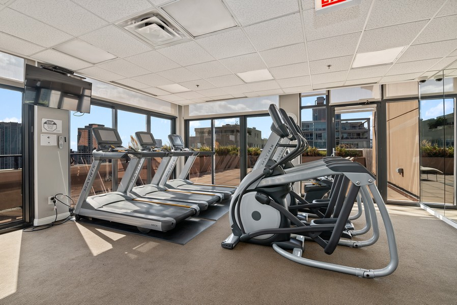 Real Estate Photography - 435 W Erie St, Unit 1102, Chicago, IL, 60654 - Exercise Room