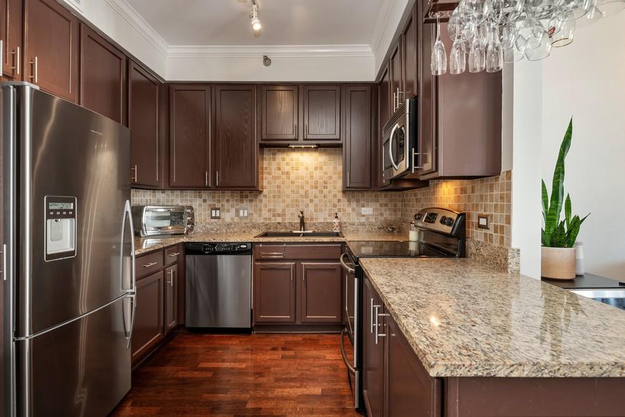 Real Estate Photography - 435 W Erie St, Unit 1102, Chicago, IL, 60654 - Kitchen