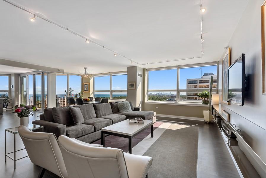 Real Estate Photography - 807 Davis Unit 1705, Evanston, IL, 60201 - Living Rm w/Breathtaking Skyline & Lake Views