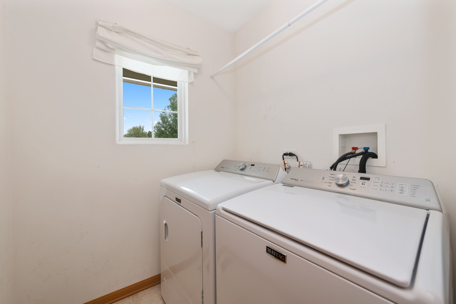 Real Estate Photography - 1435 S Wildmeadow Rd, Round Lake, IL, 60073 - 1st Fl Laundry Room