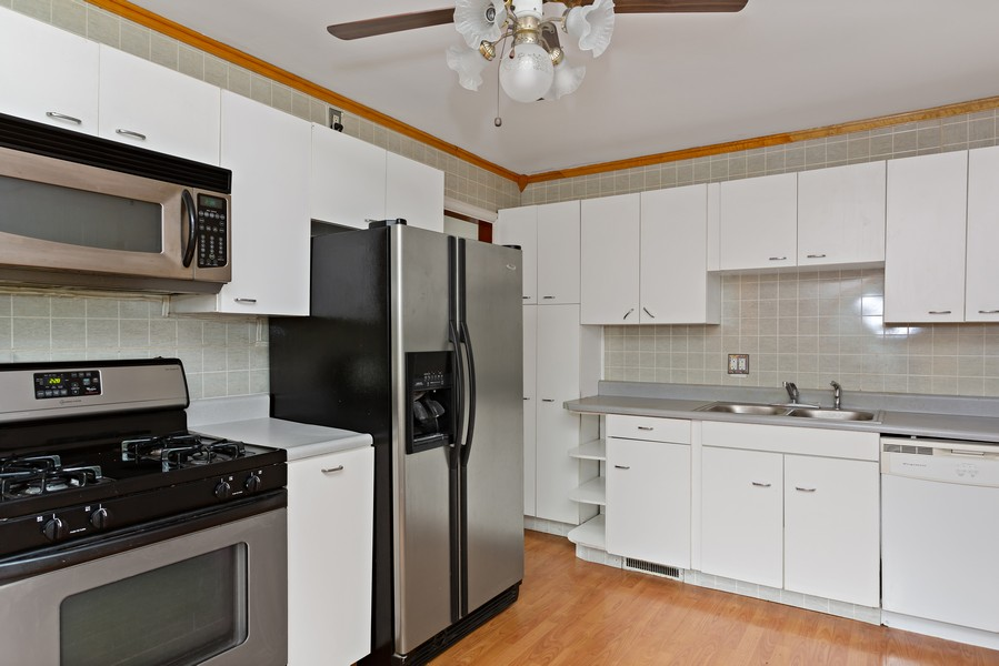 Real Estate Photography - 1924 E Coolspring Ave, Trail Creek, IN, 46360 - Kitchen