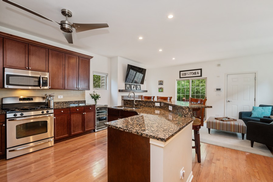 Real Estate Photography - 4520 W Larchmont Ave, Chicago, IL, 60641 - Family Room / Kitchen