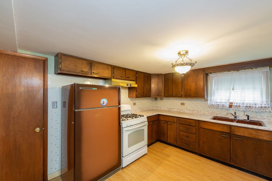Real Estate Photography - 8522 W Winnemac Ave, Chicago, IL, 60656 - Kitchen