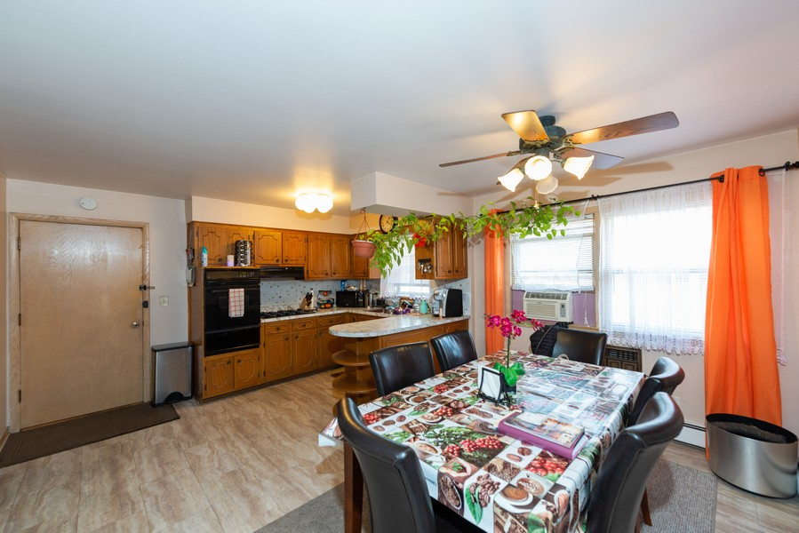 Real Estate Photography - 8522 W Winnemac Ave, Chicago, IL, 60656 - Kitchen / Breakfast Room