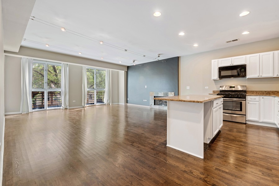 Real Estate Photography - 2902 N Central Park, 2S, Chicago, IL, 60618 - Kitchen / Living Room