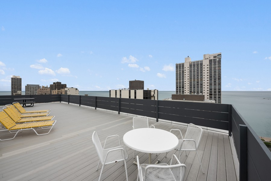 Real Estate Photography - 1300 N. Astor St., 25B, Chicago, IL, 60610 - Roof Deck - city and lake views