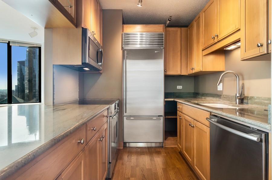 Real Estate Photography - 400 N La Salle, Unit 4207, Chicago, IL, 60654 - Kitchen