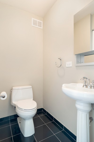 Real Estate Photography - 400 N La Salle, Unit 4207, Chicago, IL, 60654 - Half Bath
