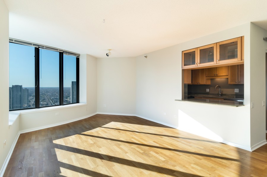 Real Estate Photography - 400 N La Salle, Unit 4207, Chicago, IL, 60654 - Kitchen / Living Room