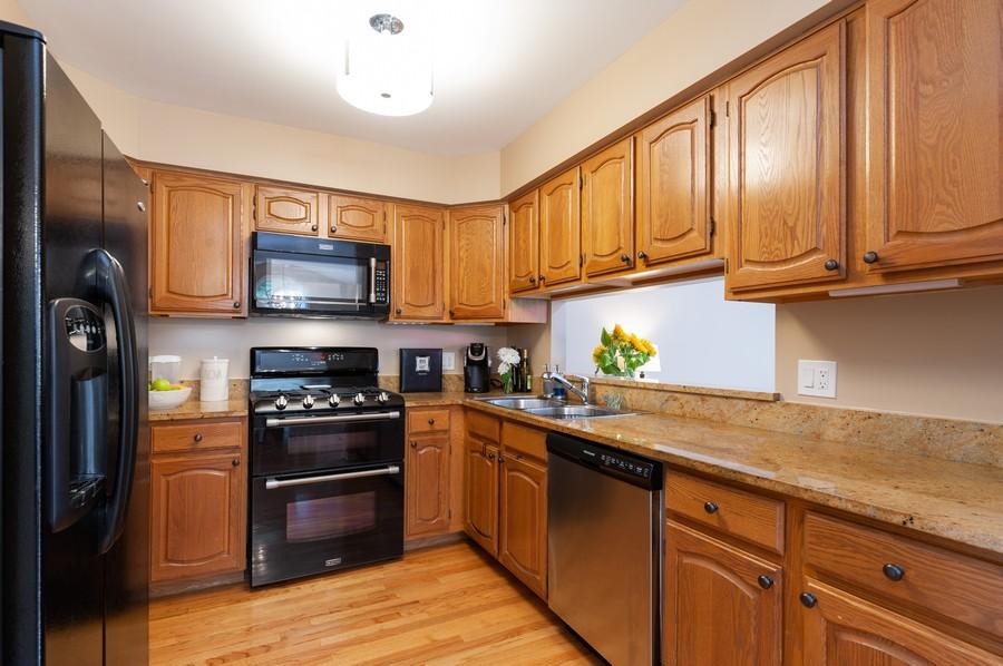 Real Estate Photography - 703 Alsace Cir, Buffalo Grove, IL, 60089 - Kitchen
