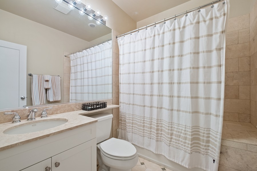 Real Estate Photography - 2754 Sheridan, Evanston, IL, 60201 - Coach house bathroom
