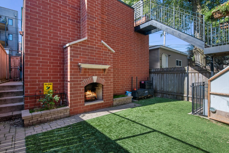 Real Estate Photography - 1938 N. Winchester, Chicago, IL, 60647 - Backyard with Outdoor Fireplace