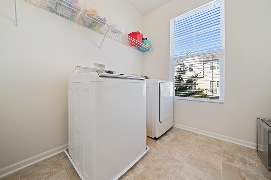 Real Estate Photography - 875 Lewisburg, Aurora, IL, 60504 - Laundry Room - off Kitchen